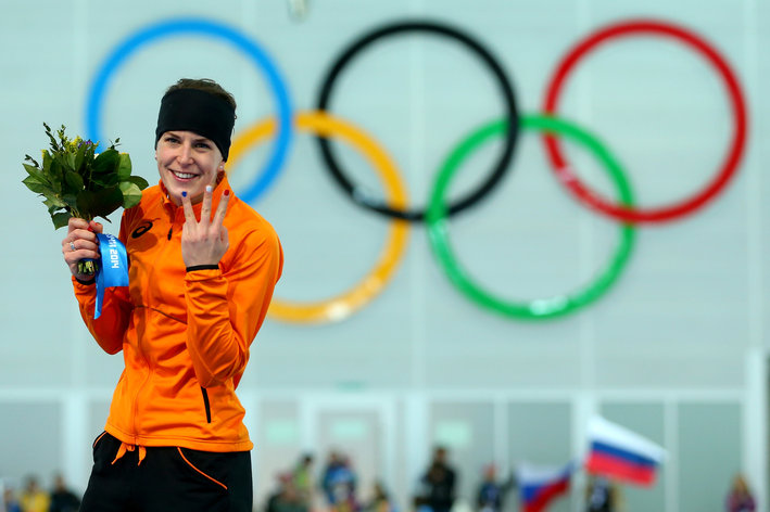 SOCHI, RUSSIA - FEBRUARY 09:  Gold medalist Irene Wust of the Netherlands celebrates on the podium during the flower ceremony for the Women's 3000m Speed Skating event during day 2 of the Sochi 2014 Winter Olympics at Adler Arena Skating Center on February 9, 2014 in Sochi, Russia.  (Photo by Quinn Rooney/Getty Images)